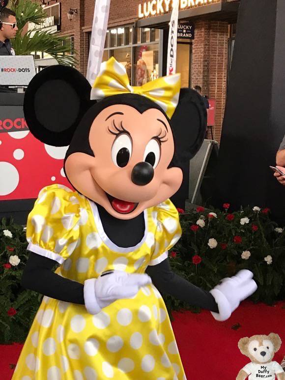 Minnie Mouse in new yellow polkadot dress designed by Olympia Le-Tan