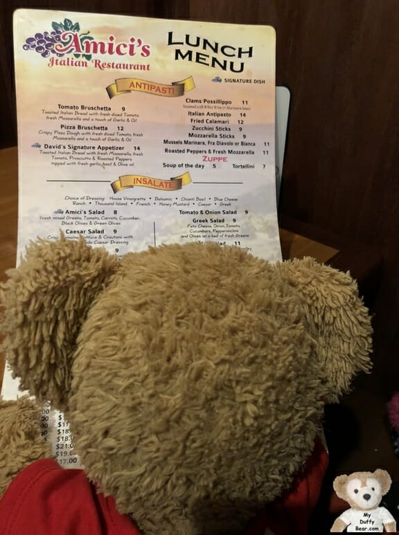 Duffy reads the Amici's Italian Restaurant Menu