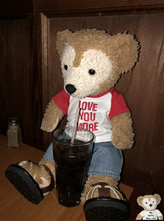 Duffy sips his coke at Amici's Italian Restaurant
