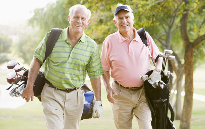 photo of two male friends enjoying a game of golf   MetroDerm P.C.