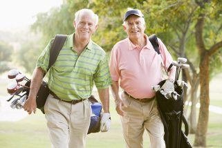 photo of two male friends enjoying a game of golf | MetroDerm P.C.