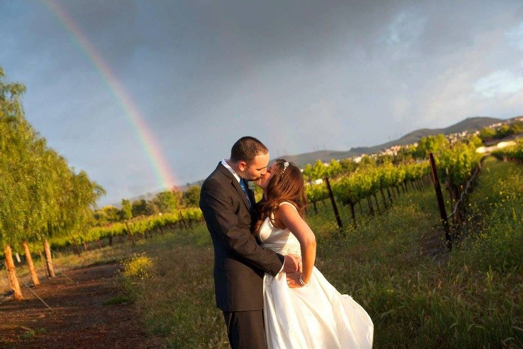 kissing under rainbow