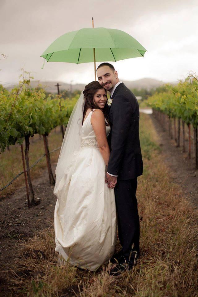 under umbrella in vineyard