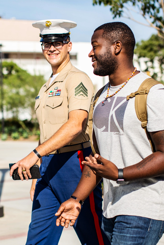 Student and Marine Walking on Campus