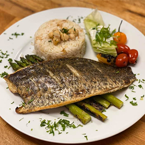 Grilled Seabass served with asparagus and rice_