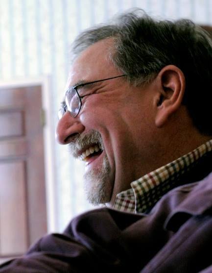 Headshot of Lee Laughing