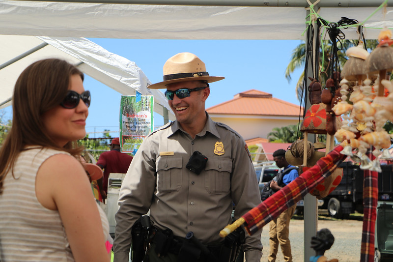 A law enforcer interacting with guests