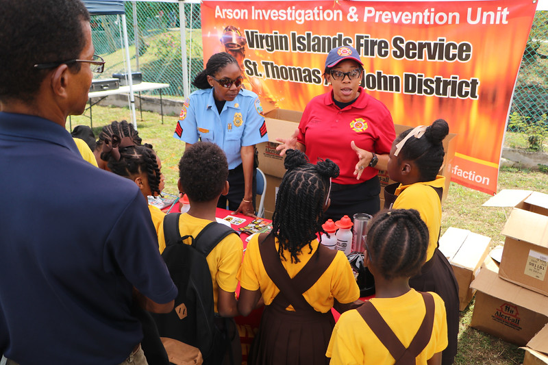 Fire safety personnel teaching kids