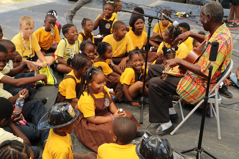 A group of children listening to music