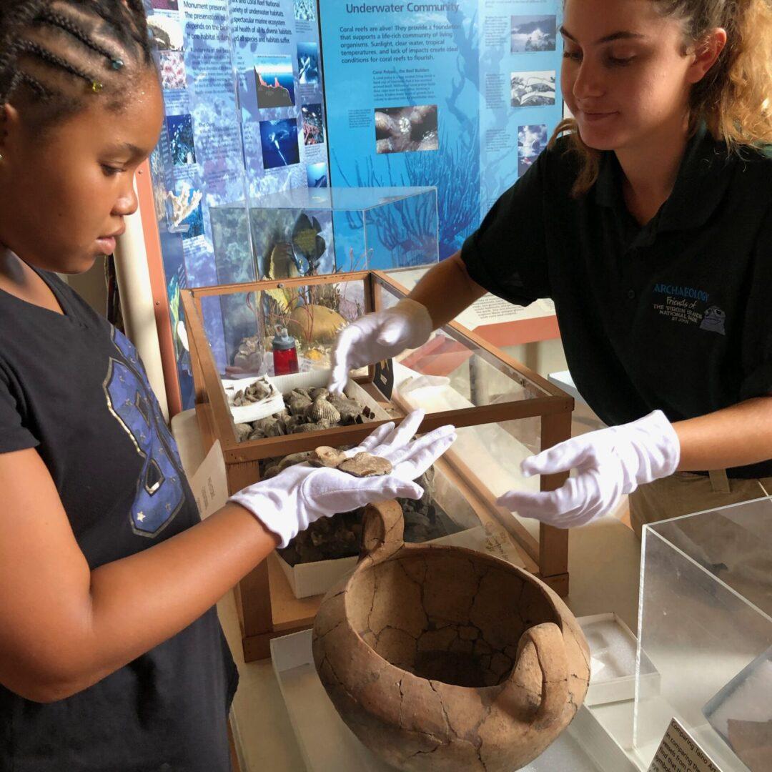 Two women examining shells