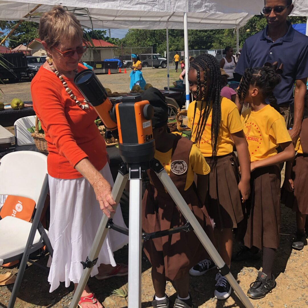 Children lining up to use the telescope
