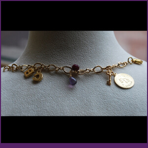 Charm Bracelet with Amethyst, Ruby and Gold from Specific Skills Jewelry Class