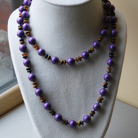 Knotted Necklace Design with Purple Pearls and Tigers Eye from Specfic Skills Class