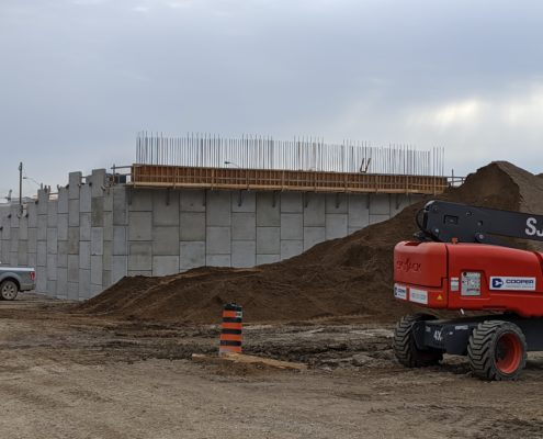 Photo showing the construction of RSS walls that will support the future alignment of Zenway Boulevard