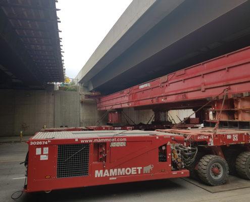 self-propelled modular transporter under Albion Bridge