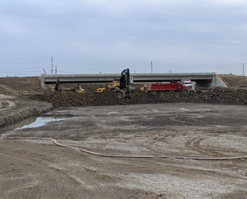 Photo showing construction in progress at the future Langstaff interchange