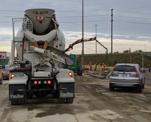Photo showing concrete being poured at a bridge deck over Albion Road