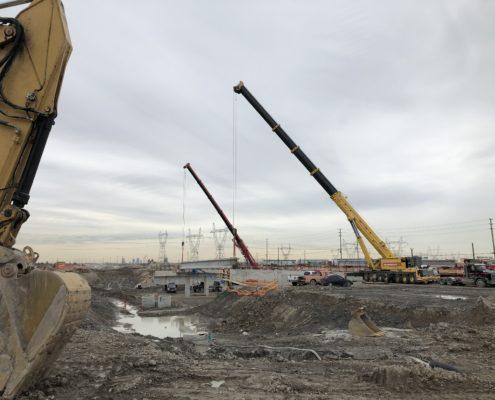 Cranes lift girders onto piers at Langstaff Road