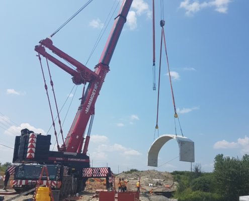 Crane lifting section of arch culvert