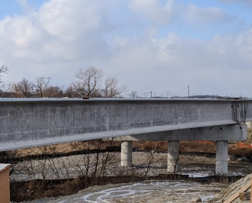 Photo of bridge girders and piers installed at Robinson Creek