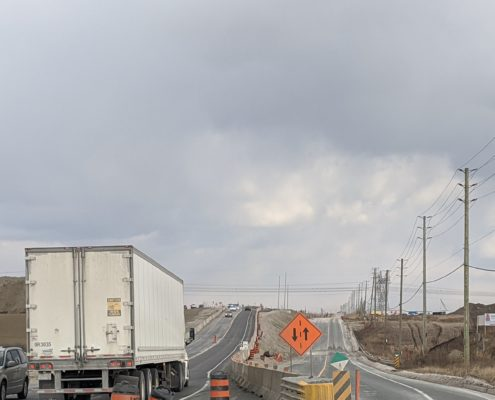 Photo of vehicles driving on the new alignment of Langstaff Road