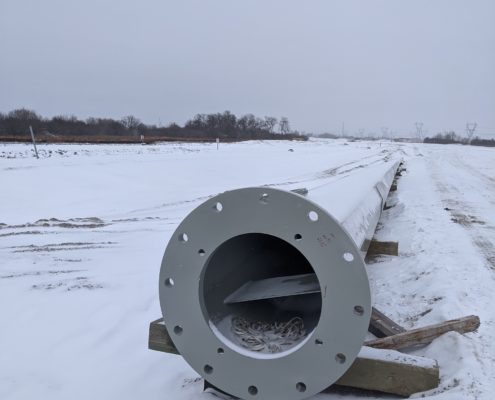 A photo of a high-mast light post ready for installation between McGillivray Road and Rutherford Road