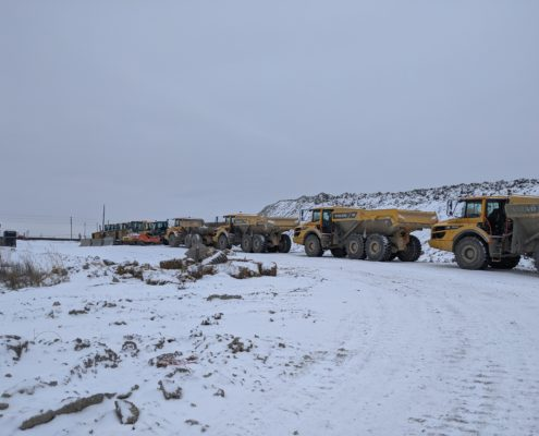A photo of parked construction vehicles near Langstaff Road