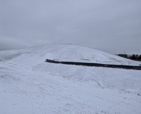 A photo of snow covered fill between Zenway Boulevard and Langstaff Road