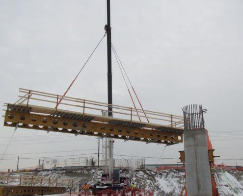bridge platform being raised for bridge construction