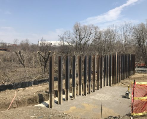 piles in the ground at Rainbow Creek for bridge construction
