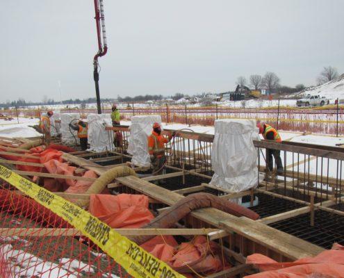 concrete being poured for bridge construction