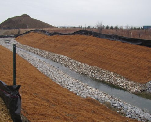 Erosion control blankets installed over exposed soils