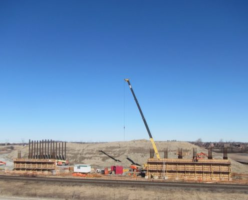 concrete forms being constructed for piers north of McGillivray Rd