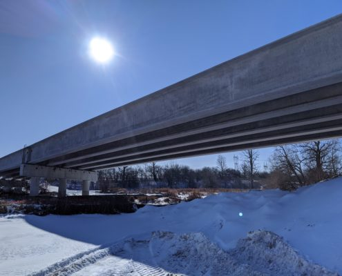 Photo of bridge girders atop piers at Robinson Creek