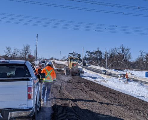Photo of a crew breaking down the old alignment of Major Mackenzie Drive near the Highway 427 interchange