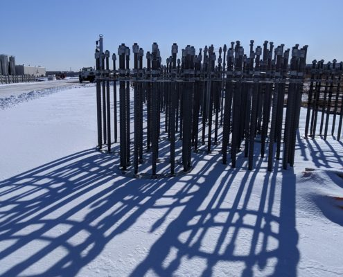 Photo of rebar for high-mast lighting foundations stored near Zenway Boulevard