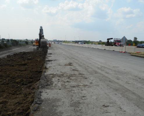 A machine operator conducts road work.