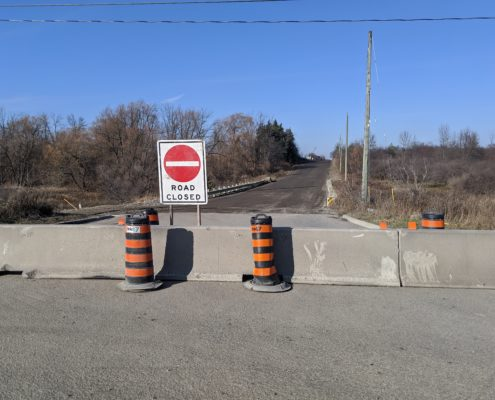 Photo of the barrier at the permanent road closure point of McGillivray Road at Rutherford Road