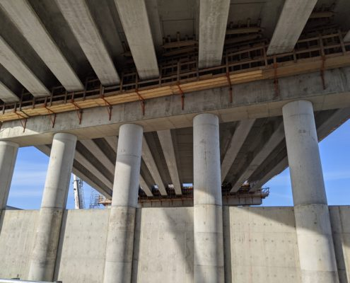 Photo of a close-up view from McGillivray Road of the Highway 427 bridge over the CP Rail tracks