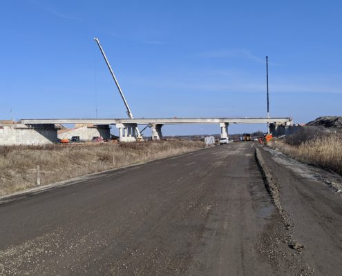 Wide view of construction progress on the Highway 427 bridge over the CP Rail tracks and McGillivray Road