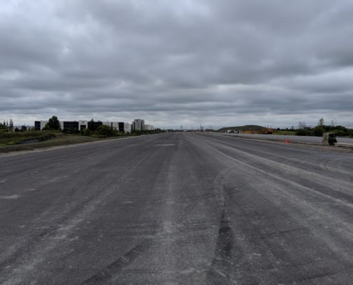 Paved road surface between Zenway Boulevard and Langstaff Road