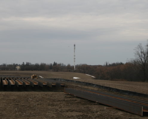 Photo of I-beams stored between Langstaff Road and Rutherford Road