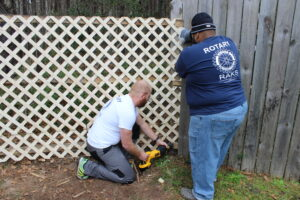 Repairing fencing at the men's shelter.