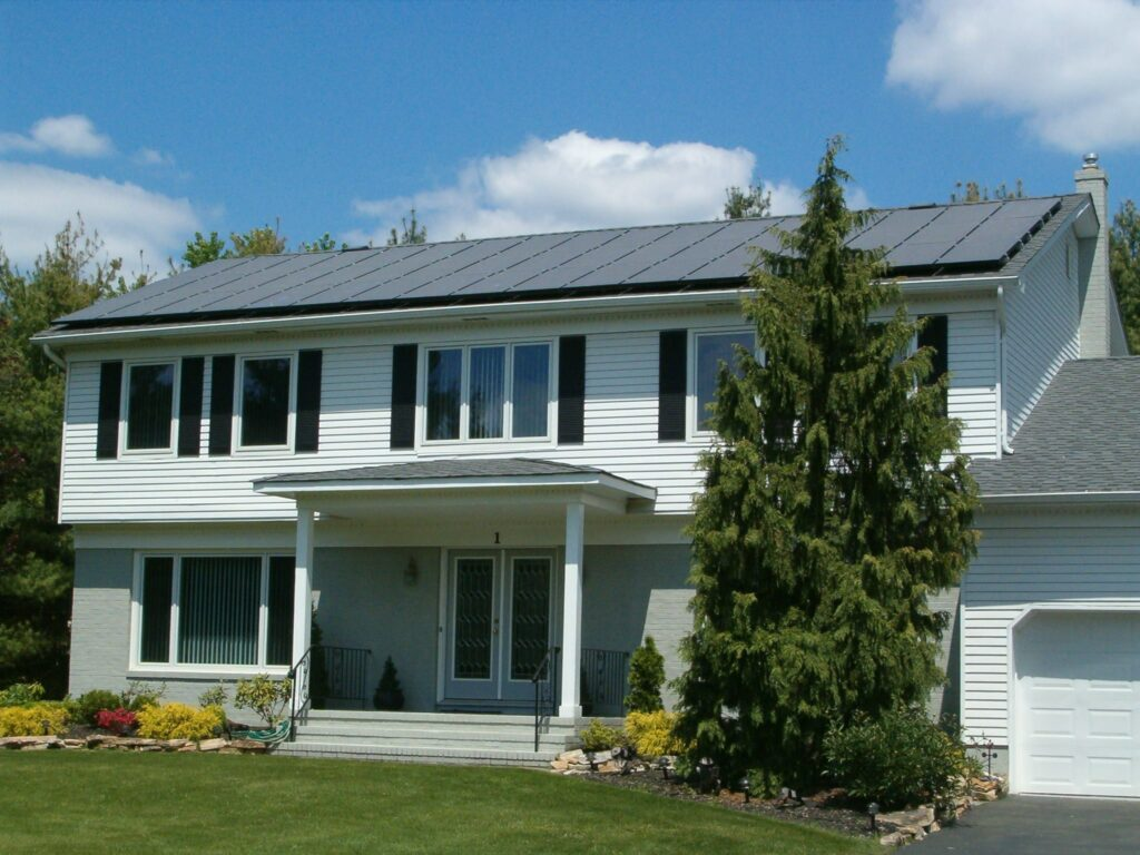 Flush mount solar panels on pitched roof