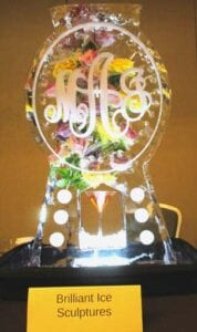 Oval monogram drink luge with fresh flowers