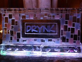 8 foot Drink Bar with Drynk Logo, we made the colored tiles on the face of the bar match their event colors. Cans of beer frozen into base
