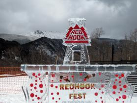 Red Hook Brewery 8 ft bar installed on top of MT WildCat Mountain Ski area, Bar features, bottle freeze-ins and redhook beer luge on top. Fun Project we had snowmobiles tow the ice to the top of the mountian.