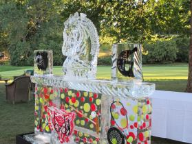 Myopia Club 8 ft ice bar with horse head drink luge, freeze-ins of rackets and tennis balls.e