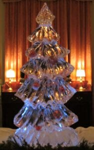 Christmas tree with candy canes and bulbs frozen into tree
