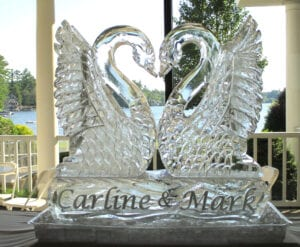 Kissing Swans with Bride and grooms name at base this is a large 2.5 block sculpture